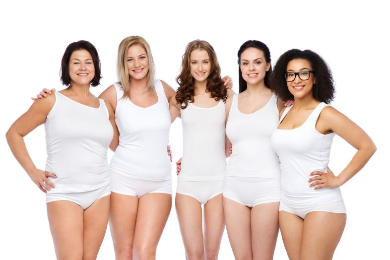 61811252 - friendship, beauty, body positive and people concept - group of happy women different in white underwear